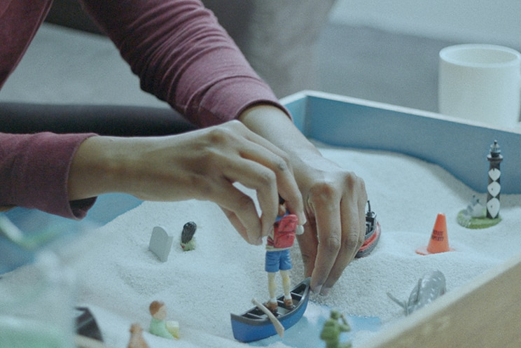 Colour still close-up of sandplay therapy from 2018 film Island of the Hungry Ghosts.
