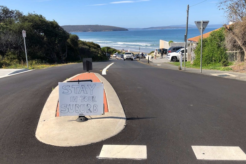 A sign at Park Beach, Dodges Ferry, urging people to stay away.