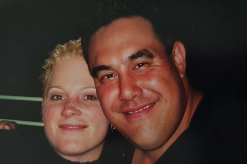 a close up photo of a young couple's smiling faces