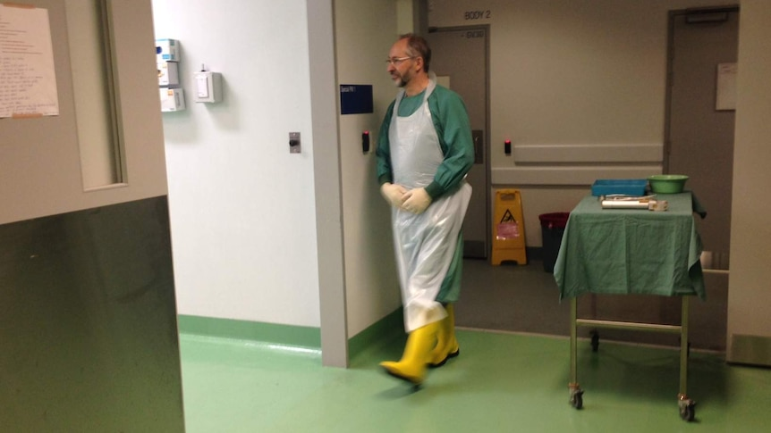 Forensic pathologist David Ranson enters the 'stage' for a performance of The Rest In Silence