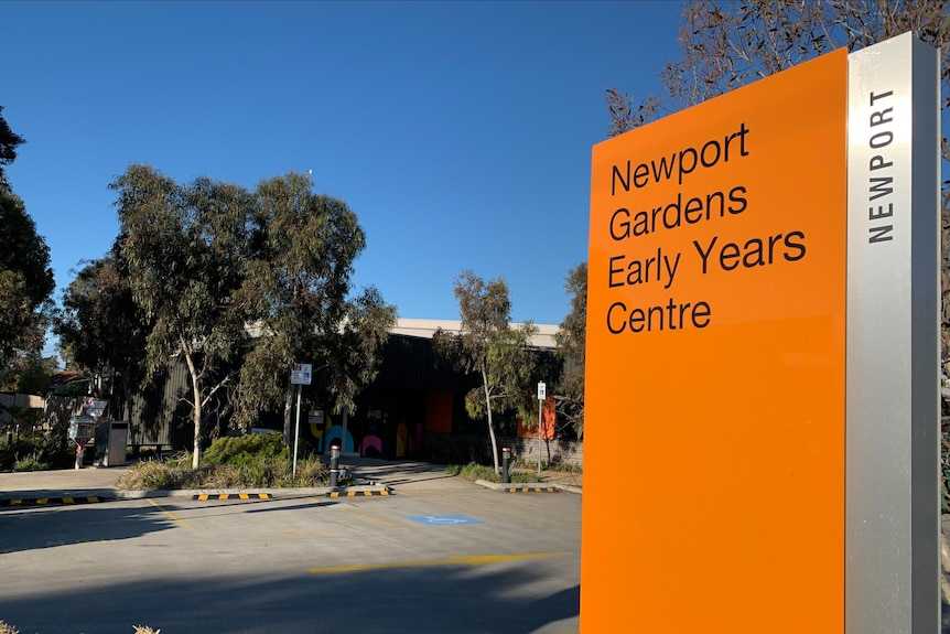 An orange sign showing the entrance to a pre school