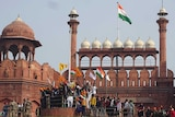 Indian farmers shout slogans from the rampart of the historic Red Fort monument