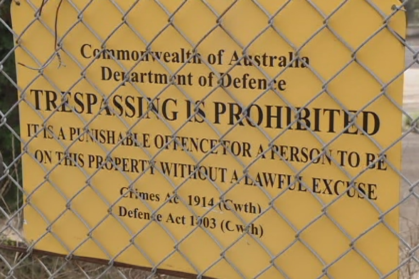 A no trespassing sign on Defence land
