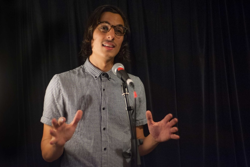 Poet Jason Marsiglia is expressive as he performs a work