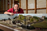 Col Bartley stands next to his model trains.