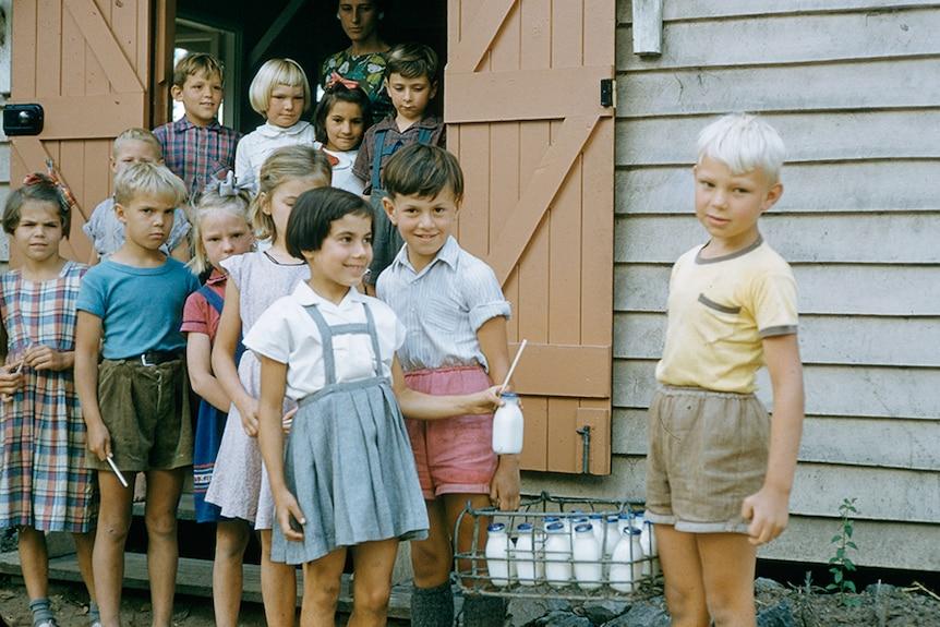 Children line up for milk at Scheyville, New South Wales, 1957