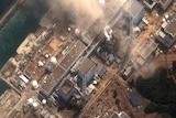 Smoke rising from the earthquake and tsunami damaged Fukushima no. 1 nuclear plant in Japan.