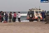 Paramedics at the scene of a shark attack at Lighthouse Beach