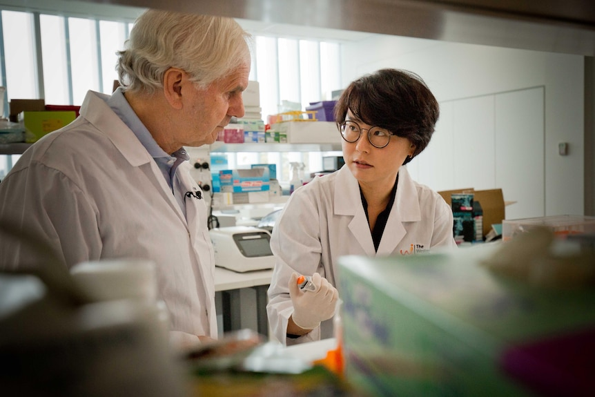 A man and a woman in a lab coat.