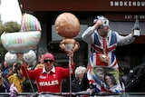 Royal fans carry balloons and champagne to celebrate in front of Windsor Castle.