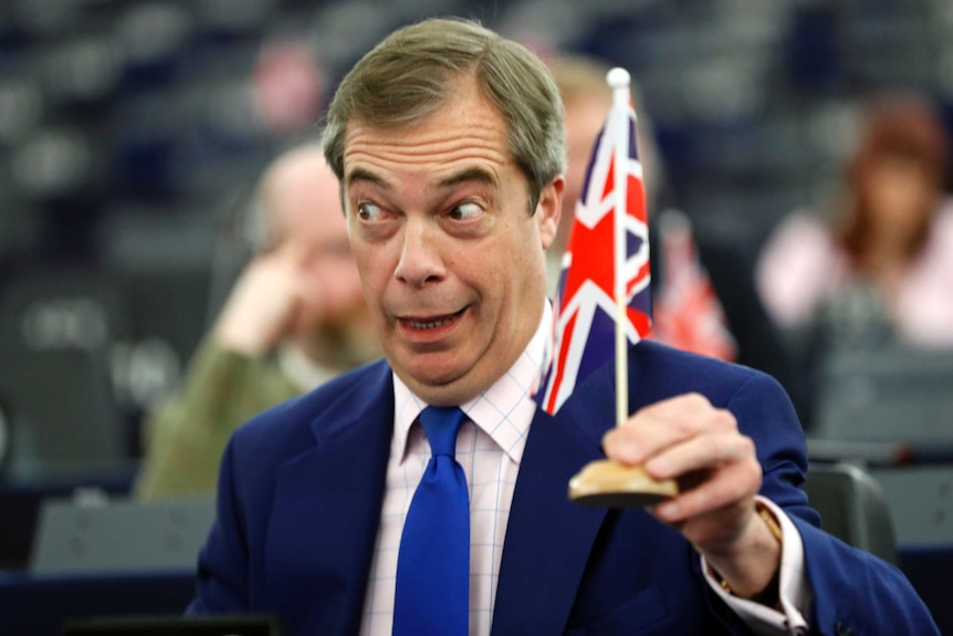 Nigel Farage holding a mini Union Jack flag
