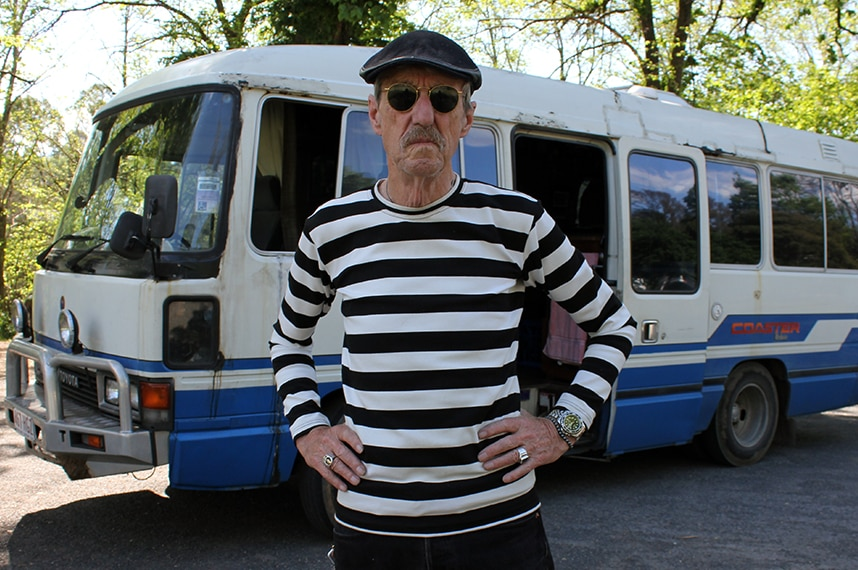 Sam Cutler, former tour manager for The Rolling Stones and the Grateful Dead, with the bus in which he now lives on the road.
