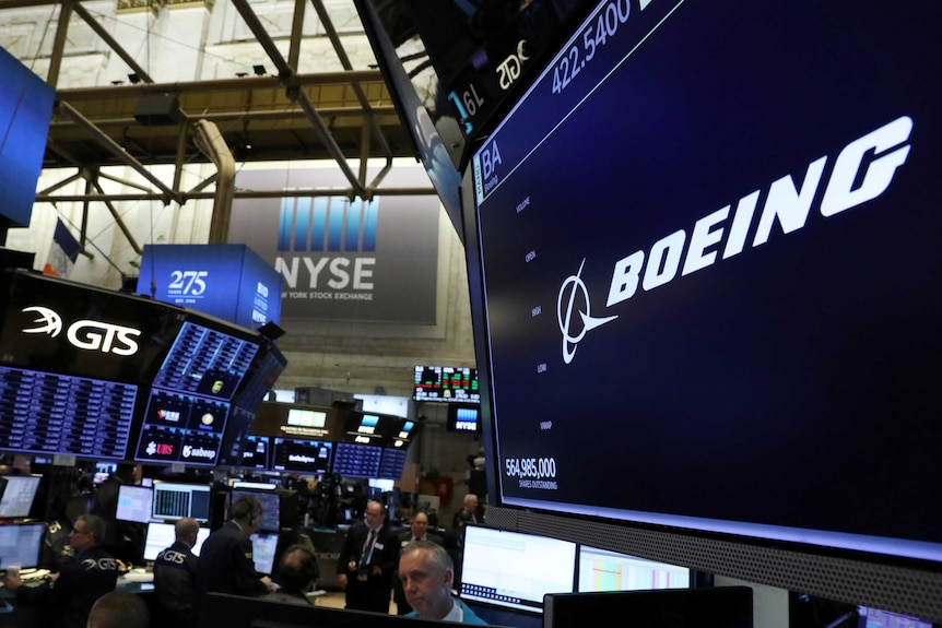 The company logo for Boeing is displayed on a screen on the floor of the New York Stock Exchange (NYSE) on March 11, 2019.