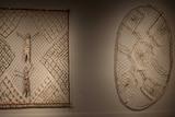 Australian Indigenous artworks hang in a gallery