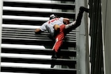 High drama: Frenchman Alain Robert, known as Spiderman, climbs the150-metre tall Lumiere apartment building in Sydney.