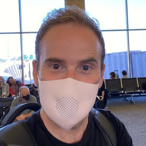 A man wears a silicone mask with a filter.