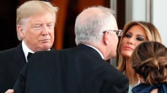 Scott Morrison kisses Melania Trump on the cheek.