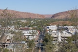 Tree in foreground, looking down over Alice Springs from ANZAC Hill.