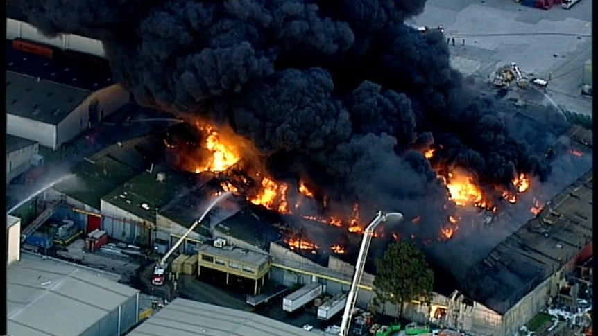 The huge blaze produced a large amount of thick, black smoke.