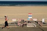 A jogger runs past closure signs at Sydney's Bondi Beach amid the coronavirus pandemic.