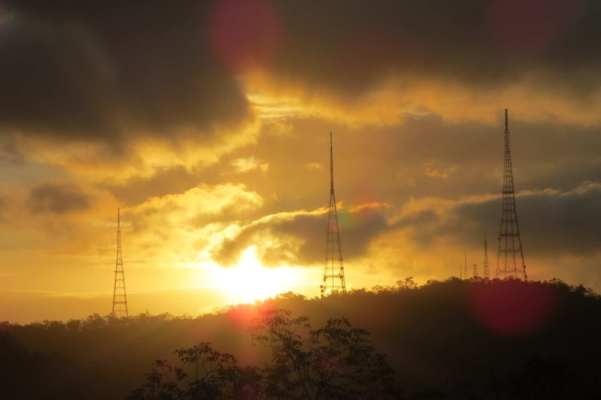 The sun sets over Mount Coot-tha in Brisbane, Queensland.