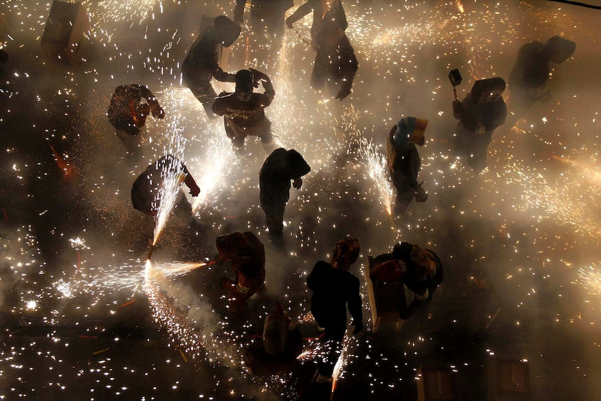 People let off fireworks during a village festival in Spain