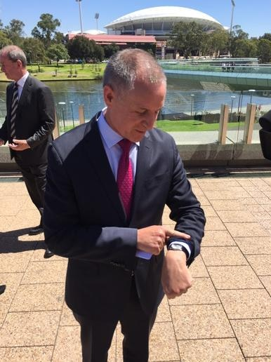 Premier Jay Weatherill looks at his watch