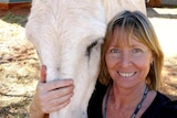 Gayle Woodford smiles with horse