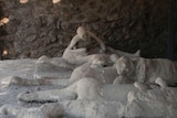 Several preserved bodies within an exhibition at Pompeii in Italy