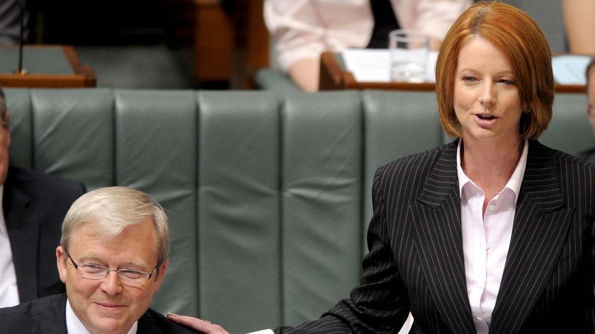 Prime Minister Kevin Rudd receives a pat on the shoulder from deputy Julia Gillard