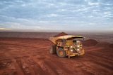 A mining truck carrying iron ore on a remote mine site.