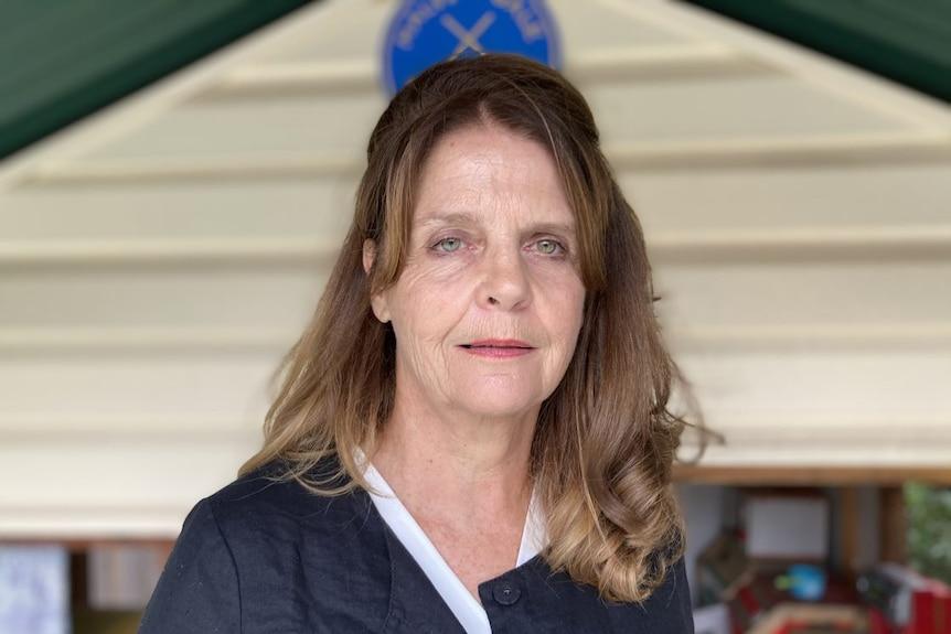 A woman with medium length brown hair.