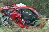 John Mansell's Porsche was doing more than 200 kilometres an hour when it crashed into a tree.
