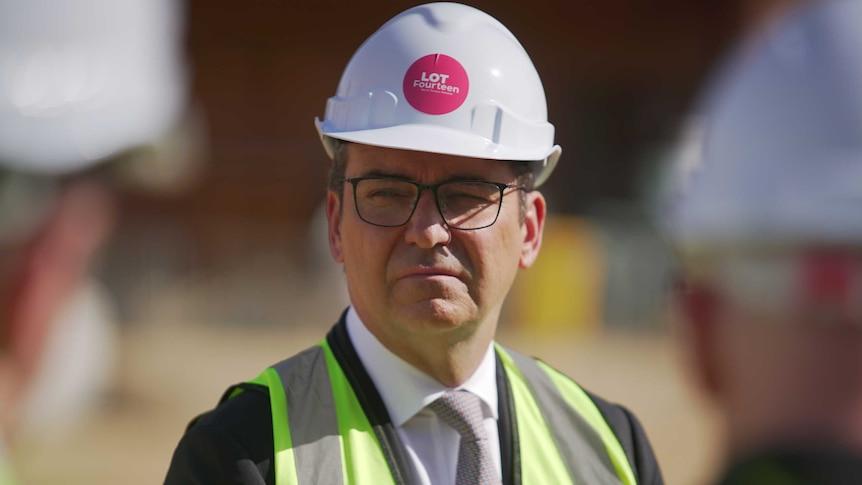 Steven Marshall in a high-vis vest and wearing a white hard hat