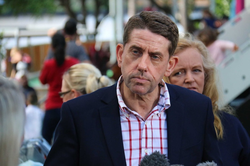Cameron Dick talking to media during a press conference in South Bank