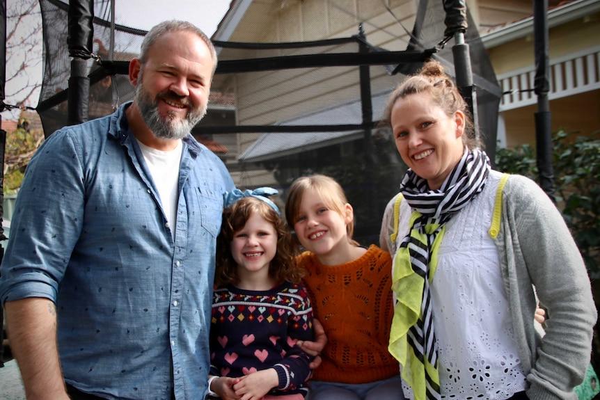 Daniel Boardman, Rosie (5), Ava (9), Kate Sindrey pose for the camera.