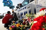 A growing memorial in front of the Dallas Police HQ