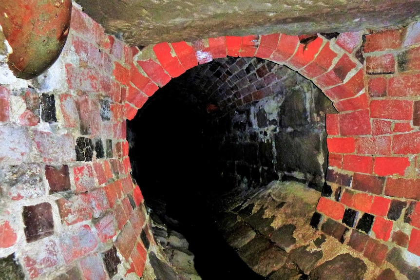 Entrance to an old brick tunnel.