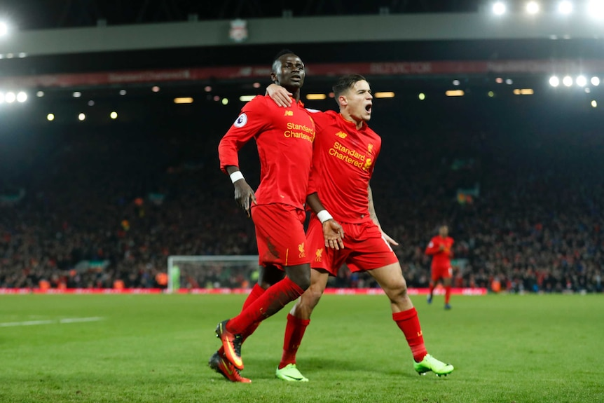 Sadio Mane and Phillipe Coutinho celebrate a Liverpool goal