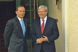Tony Abbott and Kevin Rudd share an awkward moment