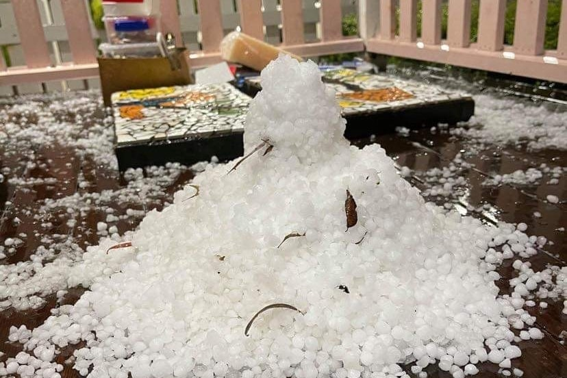 A pile of hail stacked up at ahouse at Centenary Heights in the Toowoomba region after storms.