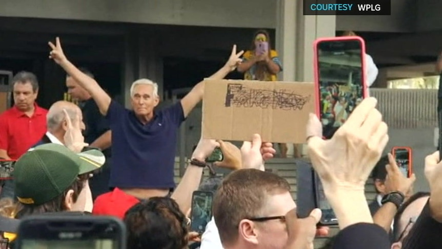 Roger Stone fronts media outside a Florida courthouse.