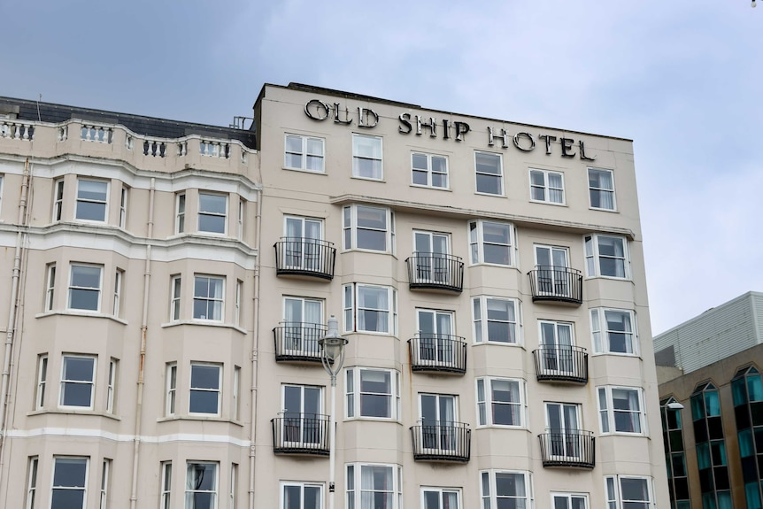 Exterior of a low-rise building  bearing the words: Old Ship Hotel.