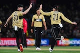 Two NZ cricketers get ready to high five in celebration after taking a wicket in T20 International.