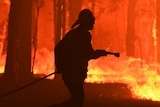 A silhouette of a firefighter surrounded by flames