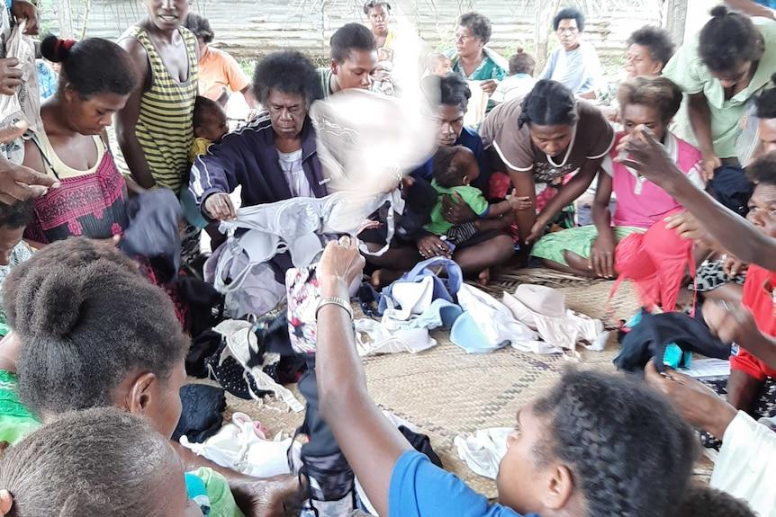 Women sorting through bras in the remote island of Futuna Vanuatu