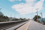 A wide shot of a vacant Seaforth train station under a blue sky in Gosnells.