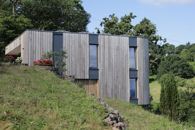 A timber-clad hillside home in Malvern, Worcestershire.