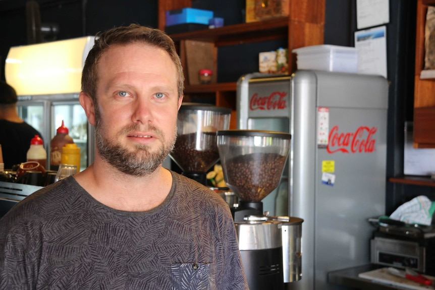 Nobby's beach cafe owner Craig Johnston in his shop on Queensland's Gold Coast.