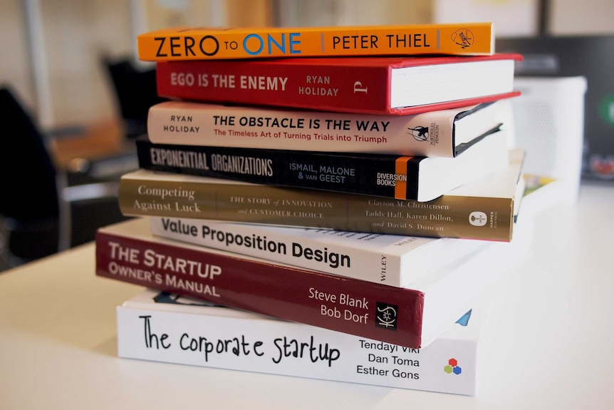 A stack of books about start-ups and which promote business success.